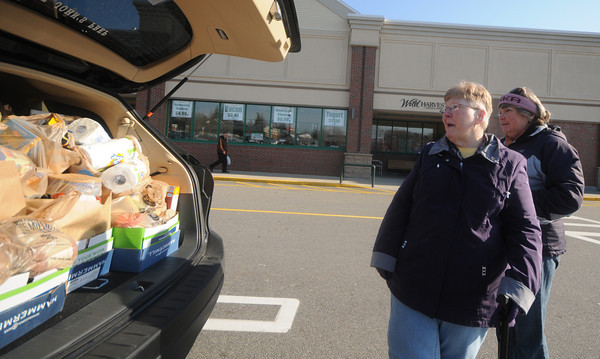 Newburyport: Janise  Cashman and Kay Marshall , both RN at the Anna Jaques Hospital, look over the food they collected at a food drive at Shaws in Newburyport Saturday. They are members of the Massachusetts Nurses Association, other members collected food at the Stop nd Shop in Amesbury. Jim Vaiknoras/staff photo
