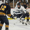 Newburyport: Triton's  Jacob Wood makes a move between 2 lynnfield players during their game at the Graf Rink in Newburyport Saturday. Jim Vaiknoras/staff photo