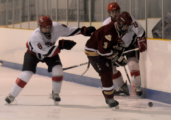 Haverhill: Newburyport's Adam McElroy fight for the puck against Amesbury's Tabor Smith and Zack Fitzgerald during their game Saturday at the Valley Forum in Haverhill. Jim Vaiknoras/Staff photo