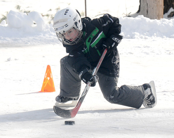Amesbury: Jeremy Conlin, 7, makes a save at the skating rink at Amesbury Park Sunday. Jim Vaiknoras/staff photo
