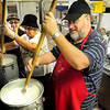 Newburyport: Father Constantine Newman, right, Pauline Rallis, left, and Daphne Tikellis stir the cream filling used in the Greek dessert galaktoboureko. They were preparing for the Greek Festival at the Annunciation Greek Orthodox Church which begins tonight and goes until Sunday. Bryan Eaton/Staff Photo