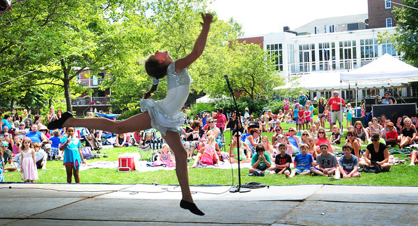 "Newburyport: Ashley Bocchetti, 10 of Georgetown jumps during a dance number to the song ""Inside of Me"" during the Yankee Homecoming Kids Talent Showcase. Bryan Eaton/Staff Photo"