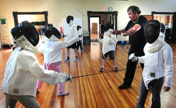 Newburyport: Jack Mullarkey of Beverly teaches youngsters some of the basic moves in fencing at the Belleville Church on Thursday morning. The class is one of many that the Newburyport Youth Services is offering this summer in various places around town. Bryan Eaton/Staff Photo