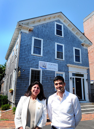 Newburyport: Sam A. Merabi, DMD, MPH with Mayor Donna Holaday has opened a new dental practice in Brown Square across from Newburyport City Hall and is having solar panels installed on the roof. Bryan Eaton/Staff Photo