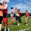 "Byfield: Members of the Orange Team get ""squeezed"" as they rally for their Peace Games at the Governor's Academy. Bryan Eaton/Staff Photo"