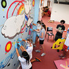 Newburyport: Newburyport High School honor students are working on a mural in the school's media center which is getting a makeover. Former student and artist, Matthew Kloss, second from right, was on hand Wednesday to help the students out. Bryan Eaton/Staff Photo
