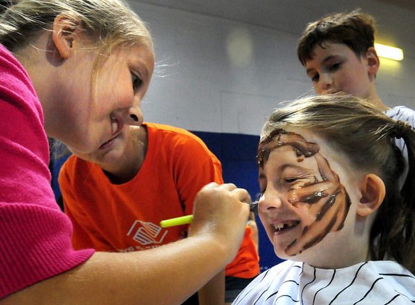 "Salisbury: Payton Baker, 10, left, paints pudding on the face of Cassidy Anderson, 7, both of Newburyport at the Boys and Girls Club on Tuesday morning in a Pudding Face Painting Race. This week's theme at the club is ""Goo Week"" which includes a Whipped Cream Relay and Blind Pudding Feeding Race. Bryan Eaton/Staff Photo"