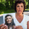 West Newbury: Linda Morrissette of Lowell holds a picture of her sister Helena Fells of Dracut who went missing in Lowell in 2006 likely falling into the Merrimack River. A shoe found in West Newbury last year with a bone in it Morrissette believes is part of the remains of her sister. Bryan Eaton/Staff Photo