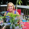 Amesbury: Joyce Halkin with thank you flowers at her Amesbury home. Bryan Eaton/Staff Photo