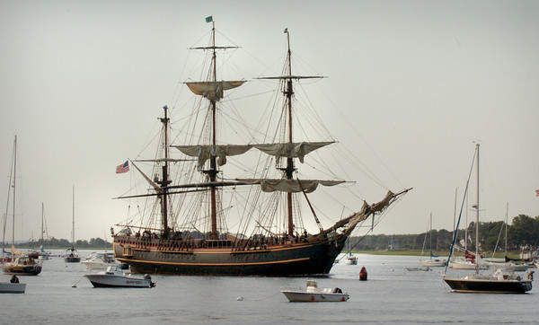 Newburyport: The HMS Bounty arrives in Newburyport yesterday morning as spectators on the Newburyport Waterfront and Ring's Island in Salisbury watched. Bryan Eaton/Staff Photo