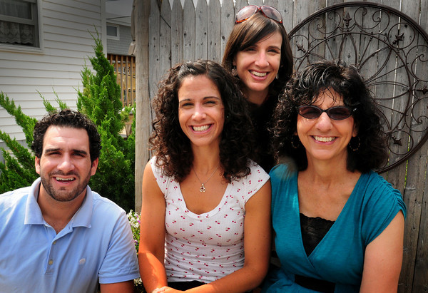 Seabrook: Lucy Milton, right, with her three children, from left, Michael, Erin and Katie. Bryan Eaton/Staff Photo