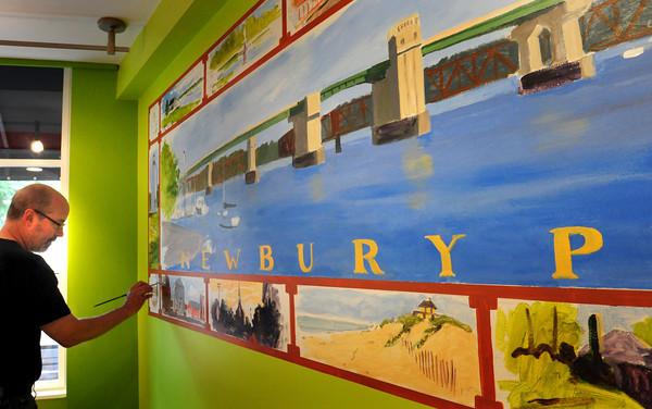 Newburyport: Alan Bull is painting a mural of Newburyport scenes in the downtown yogurt shop Orange Leaf. Bryan Eaton/Staff Photo