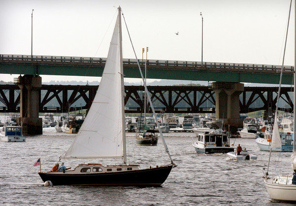 Newburyport: A rare scene in the river is a sailboat under sail of the Newburyport waterfront yesterday afternoon along with other normal boat traffic. The harbor is a little quieter now that the HMS Bounty has left which brought many visitors by foot and watercraft to see the ship. Bryan Eaton/Staff Photo