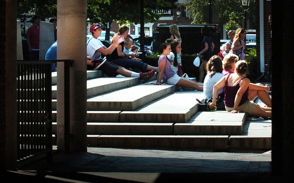 Newburyport: Spectators take up residence on the steps of the Inn Street Mall in Newburyport to take in the different musical acts taking place there yesterday afternoon. Bryan Eaton/Staff Photo