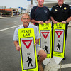 "Salisbury: The Salisbury Beach Betterment Association has purchased 16 of these ""yield to pedestrian"" signs to donate to the town's police department to install at crosswalks. From left, members Ray Champagne, president, Ron Guilmette and Salisbury police chief Thomas Fowler. Bryan Eaton/Staff Photo"