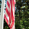 Amesbury: Gloria Borgatti has been raising and lowering the American flag on a daily basis, as weather permits, at her Amesbury home for about 40 years. Bryan Eaton/Staff Photo