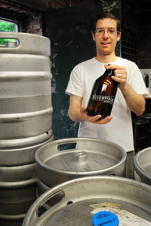 """Amesbury: Riverwalk Brewing Company's Steve Sanderson offers his beers in kegs at local restaurants and large glass """"growlers"""" to the public but plans to bottle his beers after his move to Newburyport. Bryan Eaton/Staff Photo"""