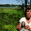 West Newbury: Linda Morrissette of Lowell holds a picture of her sister Helena Fells of Dracut who went missing in Lowell in 2006 likely falling into the Merrimack River. A shoe found in West Newbury last year, in area behind her, with a bone in it Morrissette believes is part of the remains of her sister. Bryan Eaton/Staff Photo