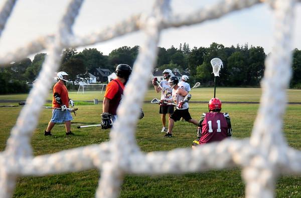 Newburyport: Newburyport adult league lacrosse practices at Fuller Field. Bryan Eaton/Staff Photo