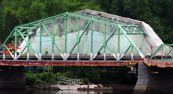 West Newbury: Parts of the Rocks Village Bridge are covered with plastic sheeting as work is well underway on the renovation of the bridge over the Merrimack River between West Newbury and Haverhill. Bryan Eaton/Staff Photo