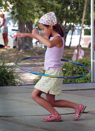 "Newburyport: Carmella Mastrangelo, 6, of Newburyport dances to ""Call Me Maybe"" while spinning a hula hoop at the Kids Talent Showcase. Bryan Eaton/Staff Photo"