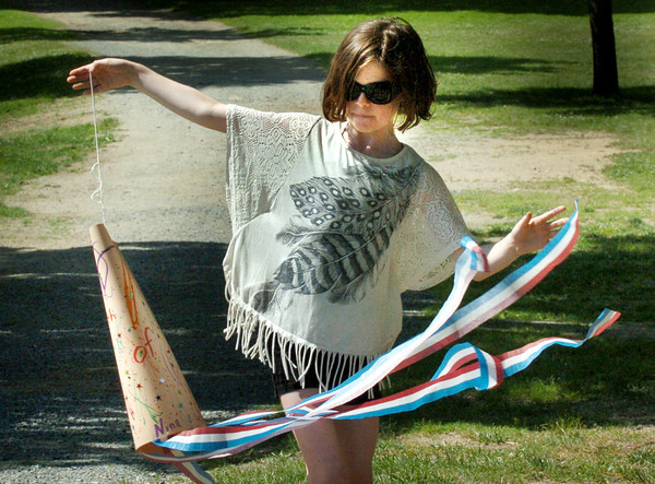 Amesbury: Nina Sesto, 9, tries out her Fourth of July-themed windsock she made at Amesbury Town Park on Monday. It was the first day of Amesbury Recreation Department's summer camp. Bryan Eaton/Staff Photo
