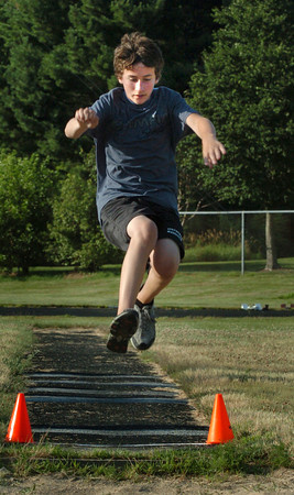 Newburyport: Marc Lundy of Merrimac in the long jump at the Summer Track Grand Prix Series at Fuller Field. Bryan Eaton/Staff Photo