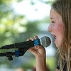 "Newburyport: Hana Sclar, 8, of Amesbury performs ""What a Wonderful World"" at the Kids Talent Showcase. Bryan Eaton/Staff Photo"