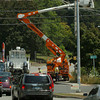 Amesbury: A utility crew works at the intersection of Main Street and Route 110 in Amesbury yesterday afternoon. Bryan Eaton/Staff Photo