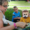 "Amesbury: Wearing his Teddy Bear mask, Ben Berg, 4, right and Julien Butzen, 5, listen as counselor Katherine Halkin reads ""I Knew You Could."" The were at the Amesbury Recreation Department's summer program where the preschoolers are read a few stories before they leave for the day. Bryan Eaton/Staff Photo"