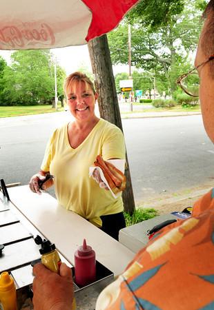 "Newburyport: Nina Fournier has her hot dog stand at ""three roads"" in front of the Atkinson Common in Newburyport. Bryan Eaton/Staff Photo"