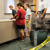Newburyport: Children taking part in Crime Scene Investigations through Newburyport Youth Services look for clues in a staged office break at the Newburyport Police Station on Friday. Inspectors Michael Sugrue, pictured, and Matt Simons have led the program which included the children fingerprinting each other. Bryan Eaton/Staff Photo