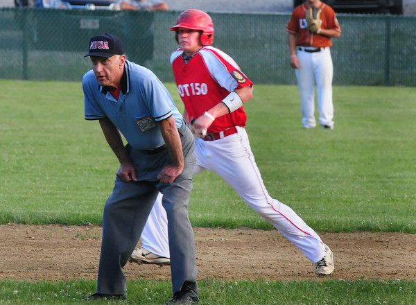 Rowley: Richard Fecteau takes a lead to third where he was landed on a single and later singled to home base. Bryan Eaton/Staff Photo