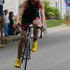 Amesbury: Connoer Murray finishes the cycling portion of the Dam Triathlon  Saturday at Lake Gardner in Amesbury. Jim Vaiknoras/staff photo