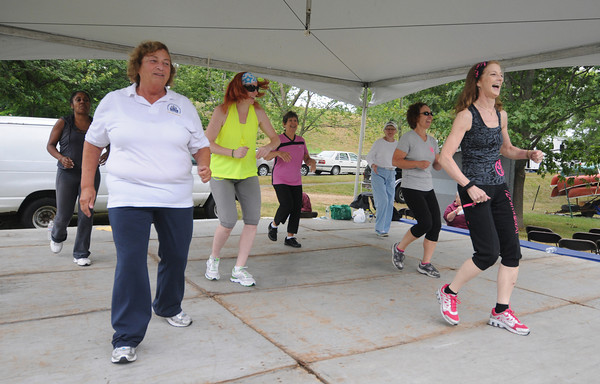 Newburyport: Susan Tribble leads former General Chairwoman Geri Dorr and others in a Zumba demonstration at Yankee Homecoming's Old-Fashioned Sunday on the Bartlet Mall. Jim Vaiknoras/staff photo