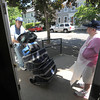 Newburyport: Meal on Wheeles site manager Cindy Rand hold the door Frances Webb as he gets ready for the days deliveries at the People United Methodist Church. Jim Vaiknoras/staff photo