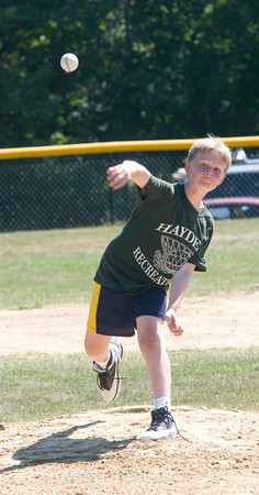 West Newbury: Ben Burnham, a desendent  of Elmer Burnham throws out the first pitch at an Allstar game at the West Newbury field named in his honor. Jim Vaiknoras/staff photo