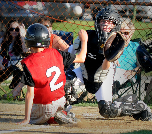 Amesbury: Groveland's Cam Ludwig waits for the throw as Amesbury Drew Everett slides safely home during amesbury 12-4 win over Groveland at the Cashman School Thursday night. Jim Vaiknoras/staff photo