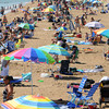 Salisbury: A large crowd begins to fill the beach to enjoy the sunshine water, Stand Up Paddling and the Sun and Sea festival in Salisbury Saturday. Jim Vaiknoras