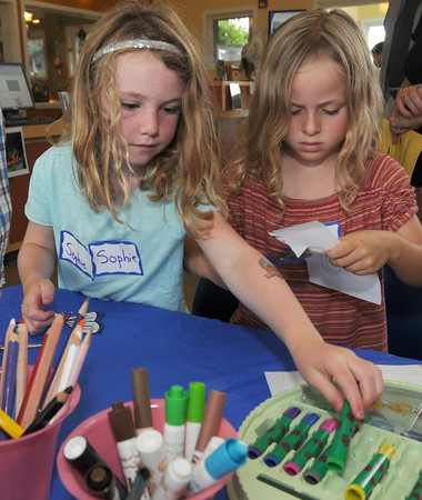 Newbury: Sophie Dack , 6, and Nola Weeder, 6, make paper butterflies at the Butterflies and Bugs Free For All event at the Mass Audubon's Joppa Flats Education Center Sunday morning. Jim Vaiknoras/staff photo