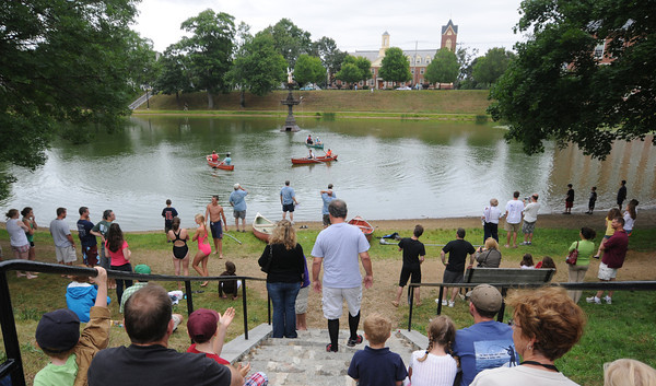 Newburyport: Spectators gather at the Frog Pond to watch competitors battle in the canoe tilt at Old-Fashioned Sunday on the Bartlet Mall In Newburyport Jim Vaiknoras/Staff photo