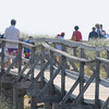 Newbury: Beach goes head to the water o the board walk off parking lot 1 on teh parker River Wildlife Refuge Sunday morning, by 11 am the lot was full as was Sandy Point at the end of the island. Jim Vaiknoras/staff photo