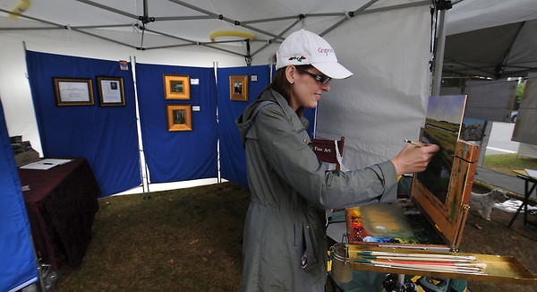 Newburyport: Artist Sharon Price of Grapevine Fine Art puts some finishing touches on one of her pieces at Old-Fashioned Sunday on the Bartlet Mall In Newburyport. Jim Vaiknoras/Staff photo