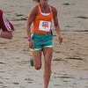 Salisbury:The first woman and 2nd over all Jessica Bailey at the Fuel Training 5k run/walk on Salisbury Beach Friday nght. Jim Vaiknoras/staff photo