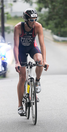 Amesbury: Dam Triathlon winner Ethan Brown finishes the cycling part of teh race Saturday at Lake Gardner in Amesbury. Jim Vaiknoras/staff photo