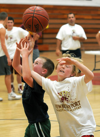 Salisbury: Finn Sullivan,8, fights for the ball with Jack Speicher,8,  during a 1 on 1 game at the Newburyport boys basketball camp competition day at the Nock Middle School Friday. Jim Vaiknoras/staff photo