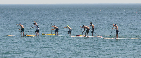 Salisbury: Racers head past shore at the 2nd annual Atlantic Paddle Battle Race Series on Salisbury Beach Saturday. Jim Vaiknoras/staff photo