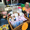 Amesbury: Madison Reed, 9, sells toy at her nana's store Fiddlestix during the Amesbury Days sidewalks sales Saturday. Jim Vaiknoras/staff photo