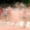 Amesbury:  Runners are covered with pink powder as the Color Run makes it's way down Main Street in Amesbury Saturday. The estimated 11,000 runners running in the 5k race were covered with colored corn starch ever kilometer. Jim Vaiknoras/staff photo