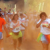 Amesbury: Orange powder cover runners  as the Color Run makes it's way down Main Street in Amesbury Saturday. The estimated 11,000 runners running in the 5k race were covered with colored corn starch ever kilometer. Jim Vaiknoras/staff photo